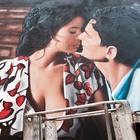 Il bacio del Postino nell'opera di Jorit a San Giorgio