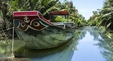 Le meraviglie del sud est asiatico viste da una barca che fluttua sul Mekong