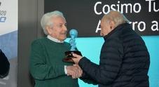A Turizio il Casco Azzurro alla carriera consegnato da Ferlaino. Scudieri: «Motor Valley, autodromo e Academy per il Sud»