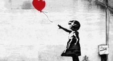 "L'opera di Banksy ""Bambina col palloncino"""