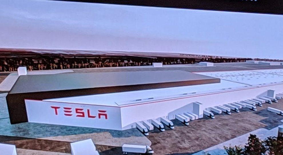 Il rendering di una fabbrica Tesla