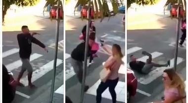 Rapinatore punta l'arma sui bambini, mamma poliziotta tira fuori la pistola e lo uccide
